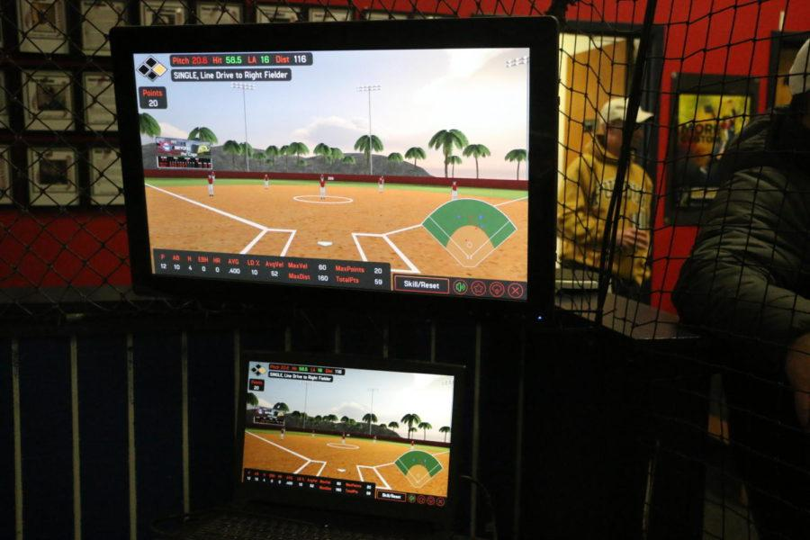 Smart Sensor: The HitTrax stimulation shows  what happens after Sophomore Olivia Roop hits a softball. Roop said she has to go to her club facility to access the technology.