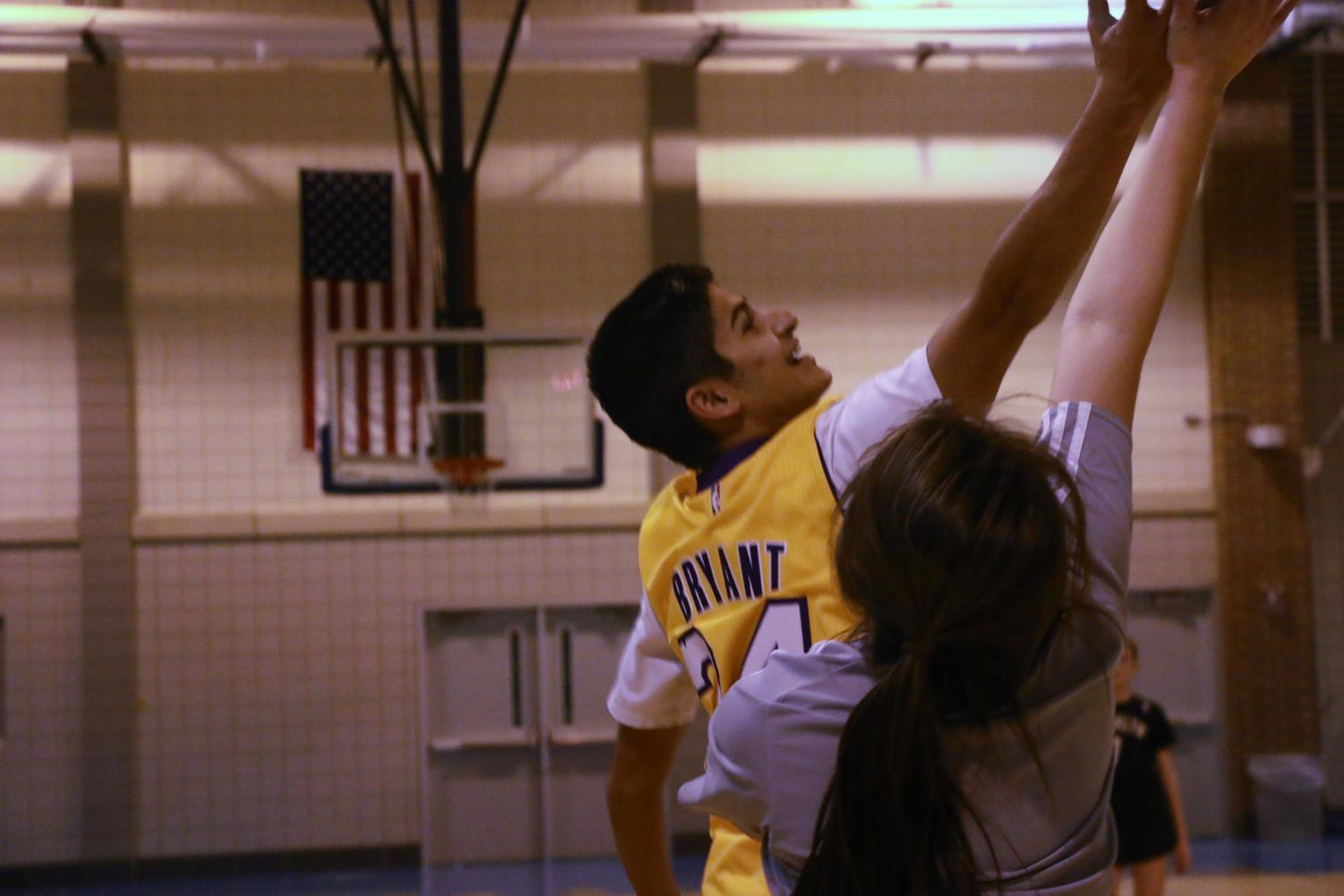 Rohil Senapati, intramural basketball player and sophomore, attempts to rebound a ball during an intramural game.