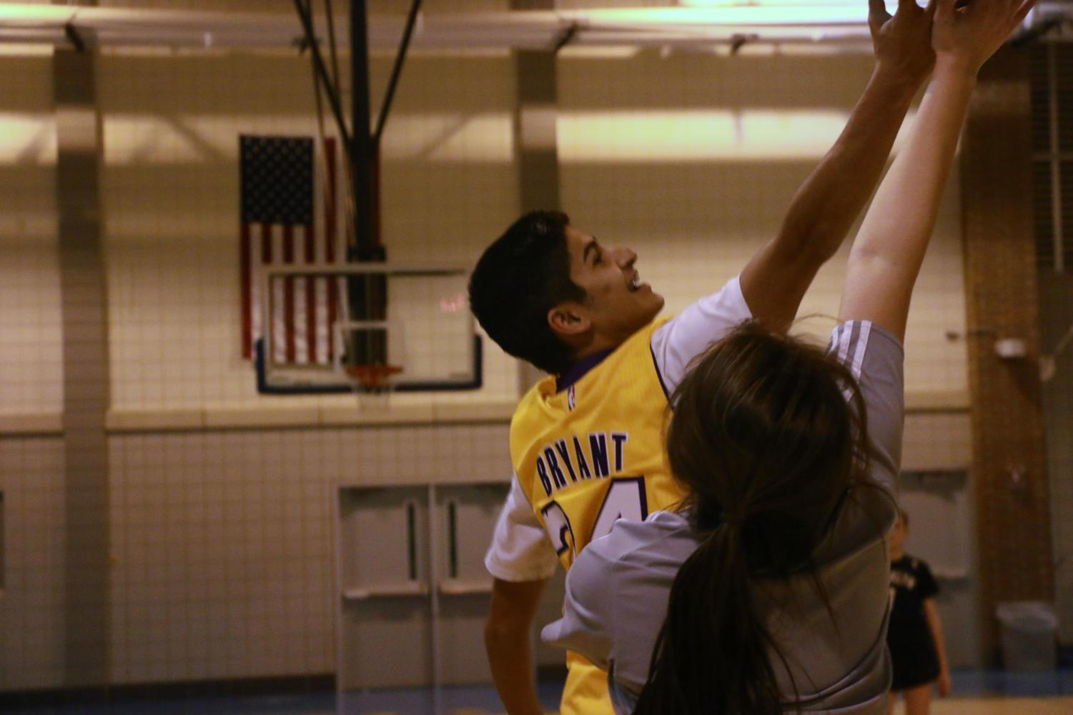 Rohil Senapati, intramural player and sophomore, attempts to rebound a basketball during one of their intramurals games.