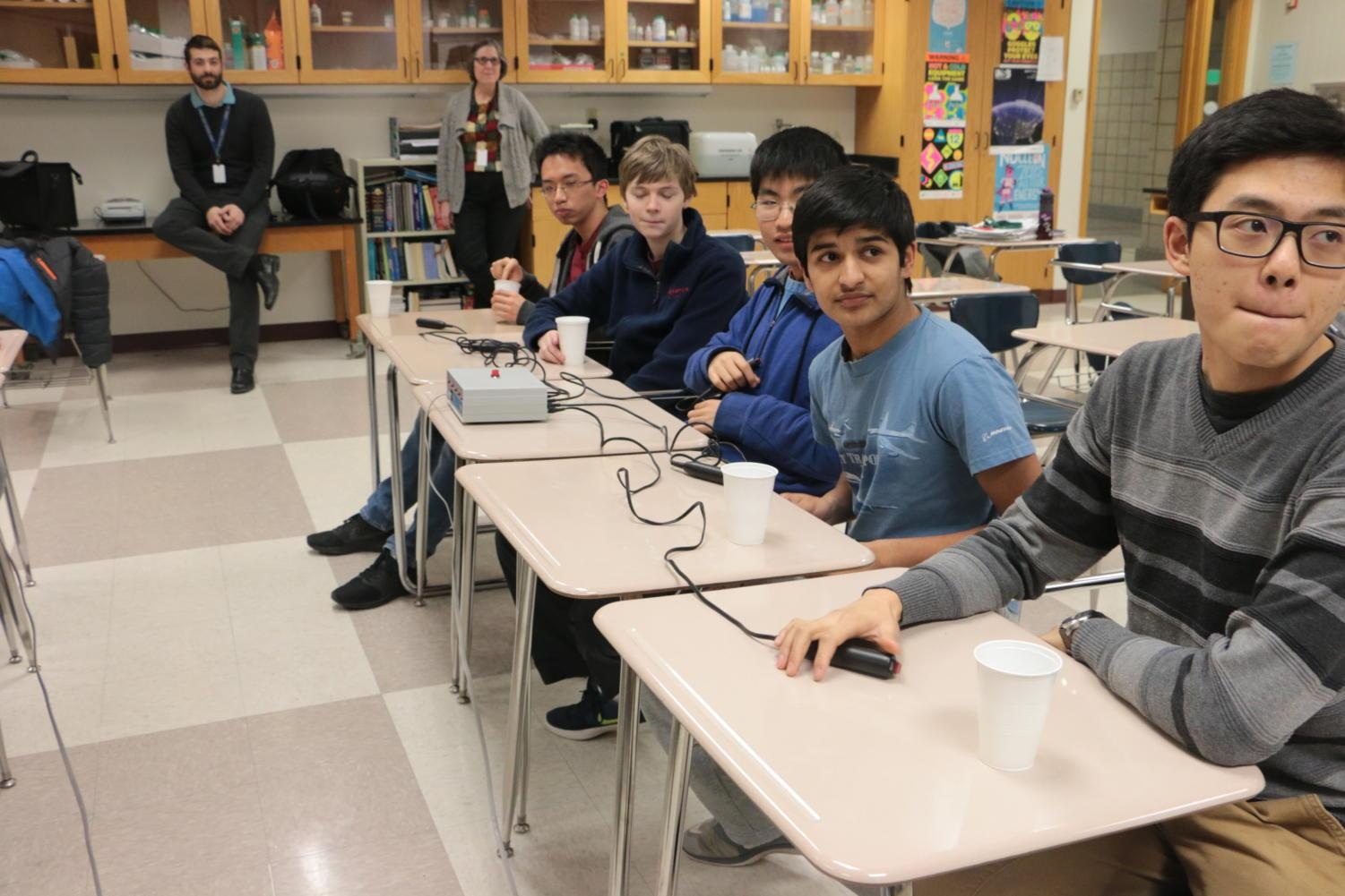 Justin Yu (front), Quiz Bowl club founder, team captain and junior, and prospective members prepare to answer a practice question during the club call-out meeting on Tuesday, March 6. According to Yu, the club hopes to prepare two teams in order to attend one invitational or competition this year.
