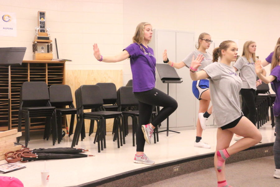 Accent and junior Julia Schmitz practices choreography during an evening rehearsal. Now that the show choir competition season is over, the Accents are starting to focus on concert choir literature, despite not attending ISSMA State qualifications.
