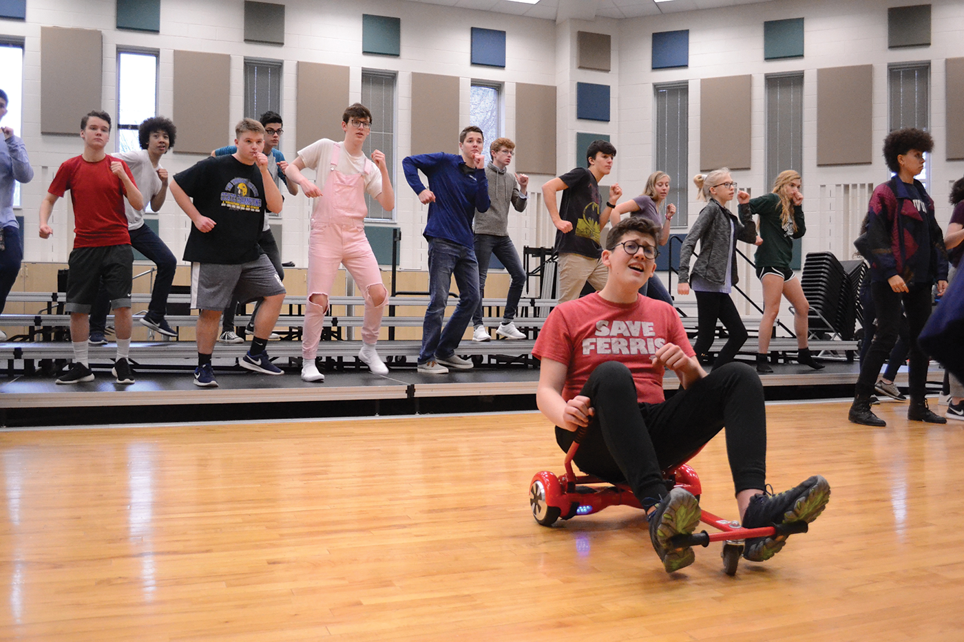 """""""The Little Mermaid"""" cast members practice a scene from the play. Jack Ducat, shown above riding the hoverboard, said he believes the modernization of the play allows for more possibilities for portraying the environment better while also giving the audience something different from past plays."""
