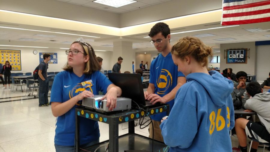 Megan Singer, Sam Bruns and Laura Dobie, TechHOUNDS members and seniors, set up for a meeting. TechHOUNDS is currently in the middle of its competition season and competed at Purdue University on Saturday, March 31.​