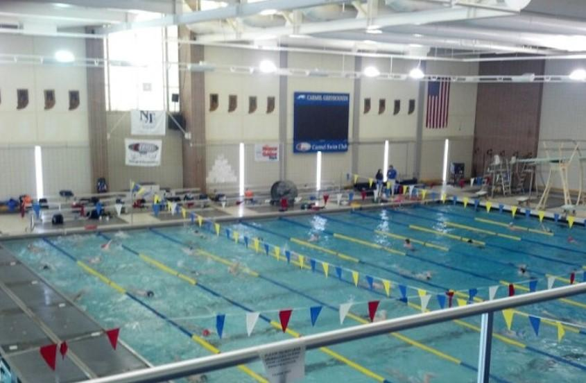 Members of the Carmel Swim Club practice in the aquatics center. The aquatics center began preparations for their upcoming triathlon and meet.