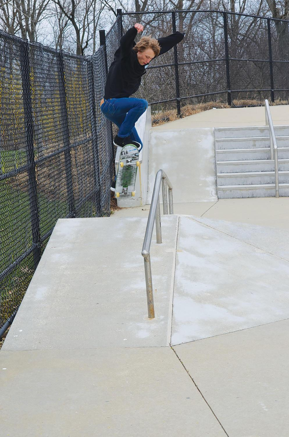 AIR TIME: Skateboarder and junior Mitchell Johnson jumps a rail in James Dillon skatepark. Johnson said he likes how the Monon Center has rails so he can practice his new tricks. Agrayan Gupta | Photo
