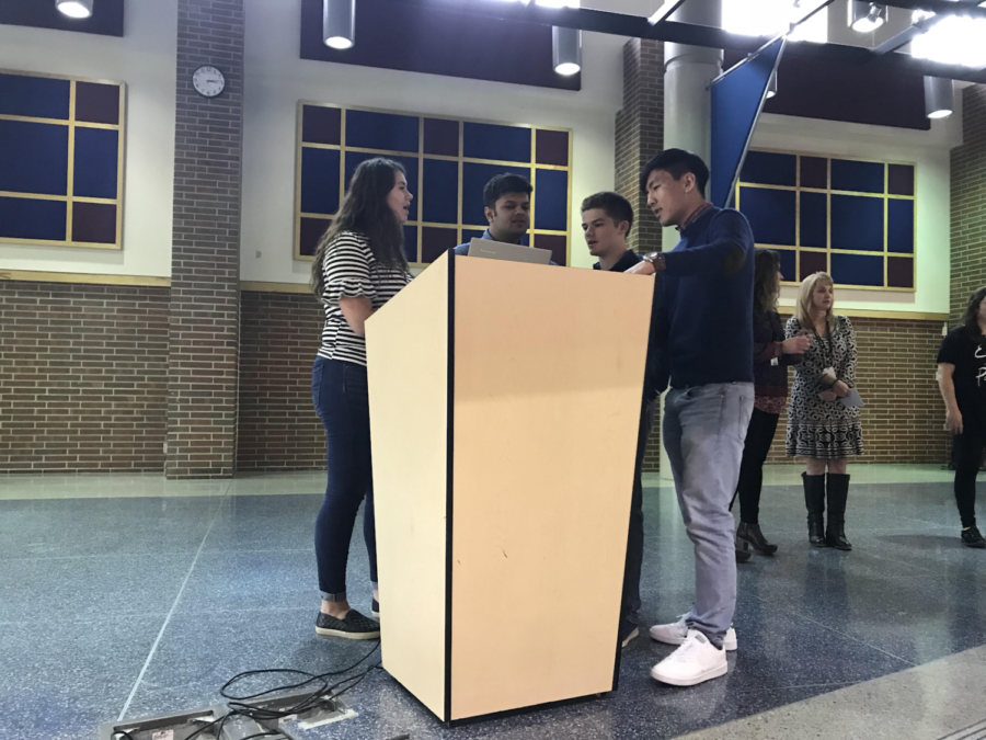 NHS officer Jai Sanghani, Hannah Glazier, Justin Park and Dalton Thompson discuss the meeting's agenda before addressing the juniors who will be joining NHS next school year. The officers told the juniors about the responsibilities that come with being an NHS member and addressed the semi-formal dress code for the induction ceremony on April 22.