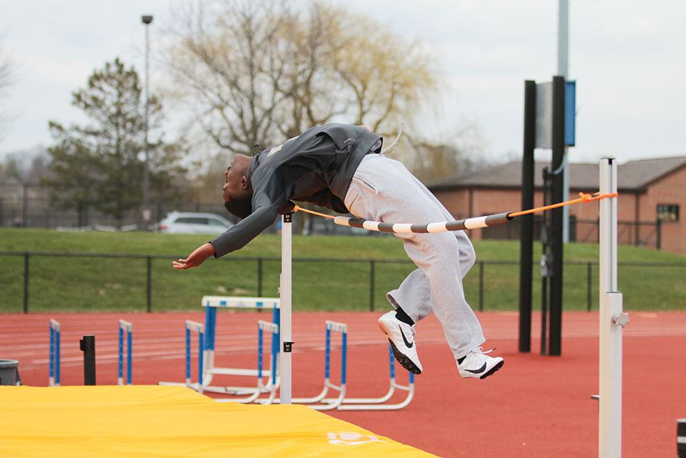 Ryan Macharia, high jumper and sophomore, rehearses his event during practice. The team will have its next home meet on Tuesday.