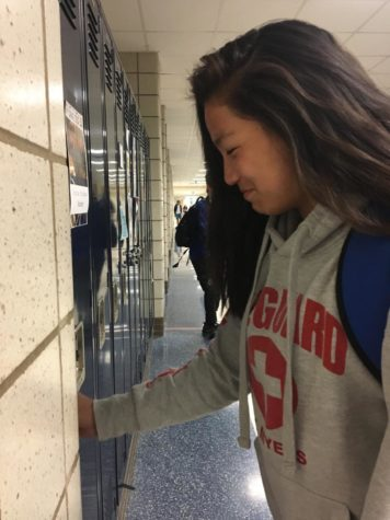 "Ellie Backer opens her locker in the CHS freshman center on her way to class. She explained why she likes playing Carmel Dad's Club soccer instead of high school soccer. ""I think the experience with CDC is more fun because when you're at Carmel High School, there's just a lot more stress for a high school sport. You do not want to be the one to mess up or ruin the reputation of the team,"" Backer said."