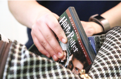 Tragesser packs a Harry Potter movie into her suitcase. She said she plans on taking  some of her favorites movies to help the transition into her new dorm and her new life.