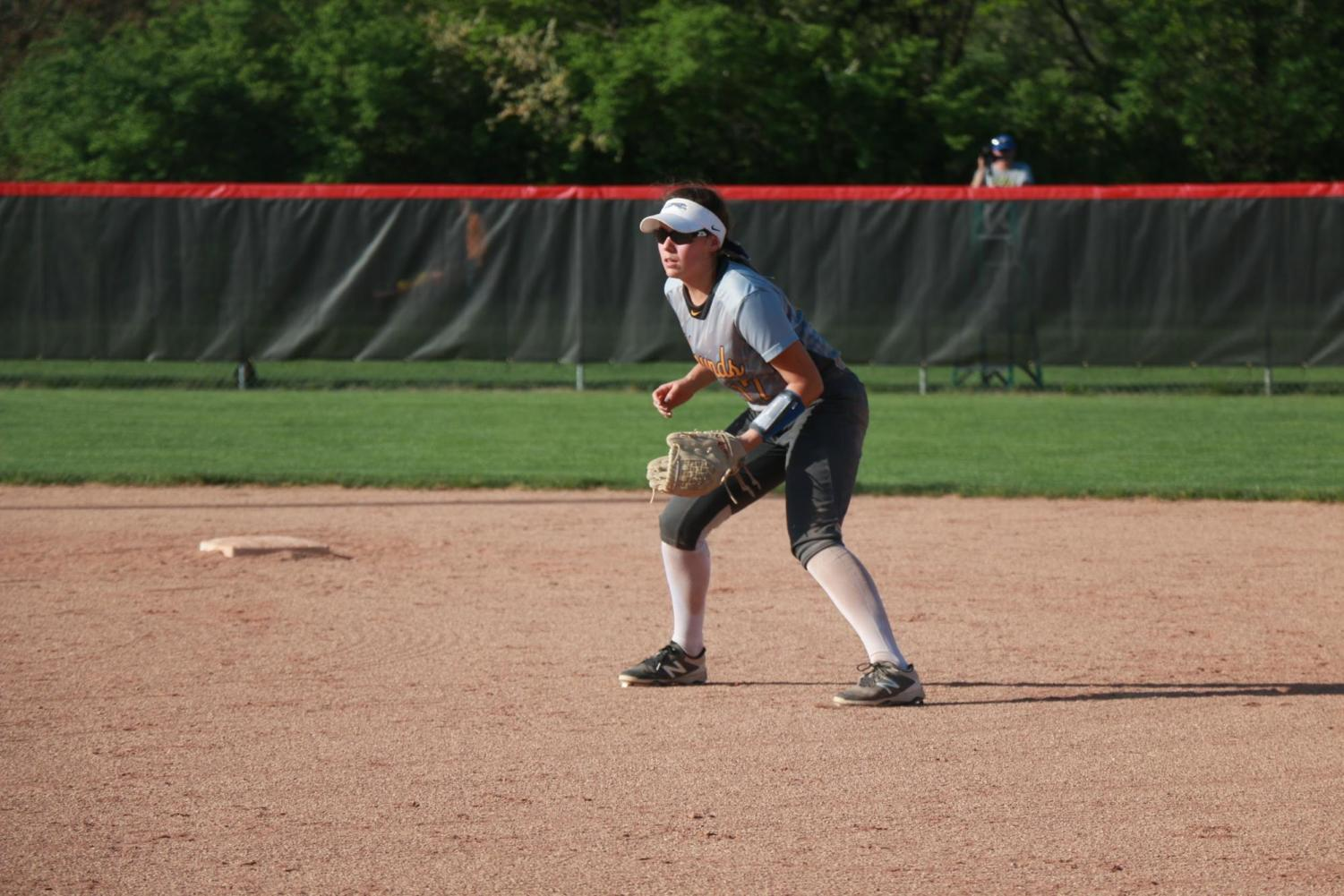 Sophomore Brooke Bair gets in a ready position at second base. Bair broke her leg at the game against North Central on May 8 by colliding with right fielder Ella Greenawald, both trying to catch a fly ball.