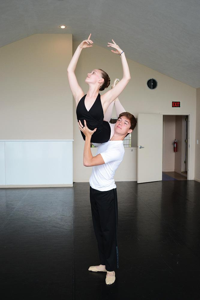"""Dancer and sophomore Lindsey Thole rehearses with her partner at Performer's Edge Dance Studio. Here, she worked on the """"bluebird"""" position."""