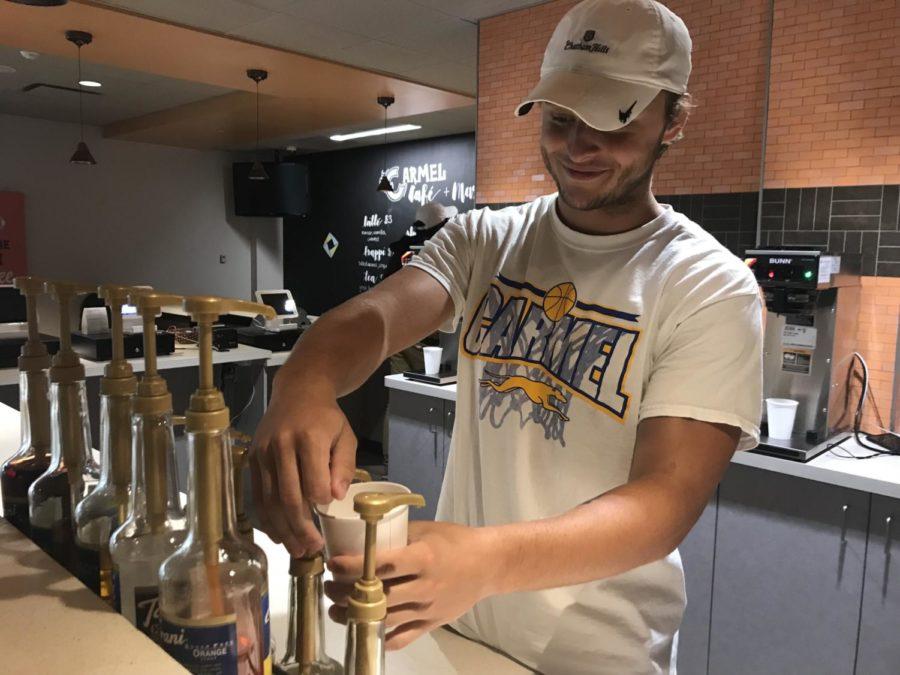 Senior Joey Schmidt makes a drink for a customer in the Carmel Café during SRT. Schmidt said,