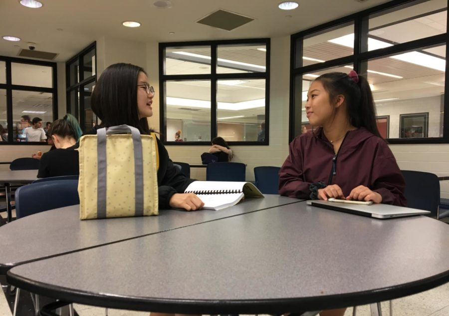 Hannah Na and Vivian Zheng, Design for CHS members and juniors, eat lunch together. Design for CHS had their call-out meeting on Sept. 12 and have begun planning for both new and old volunteer projects.