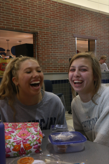 "Juniors and dancers Lexi Dungey (left) and Maddy Massa (right) have lunch together as team members. The girls try to balance school, dance and socialization. ""When we are together outside of practice, we bond in ways that benefit our sportsmanship and time together on the team,"" Massa said."