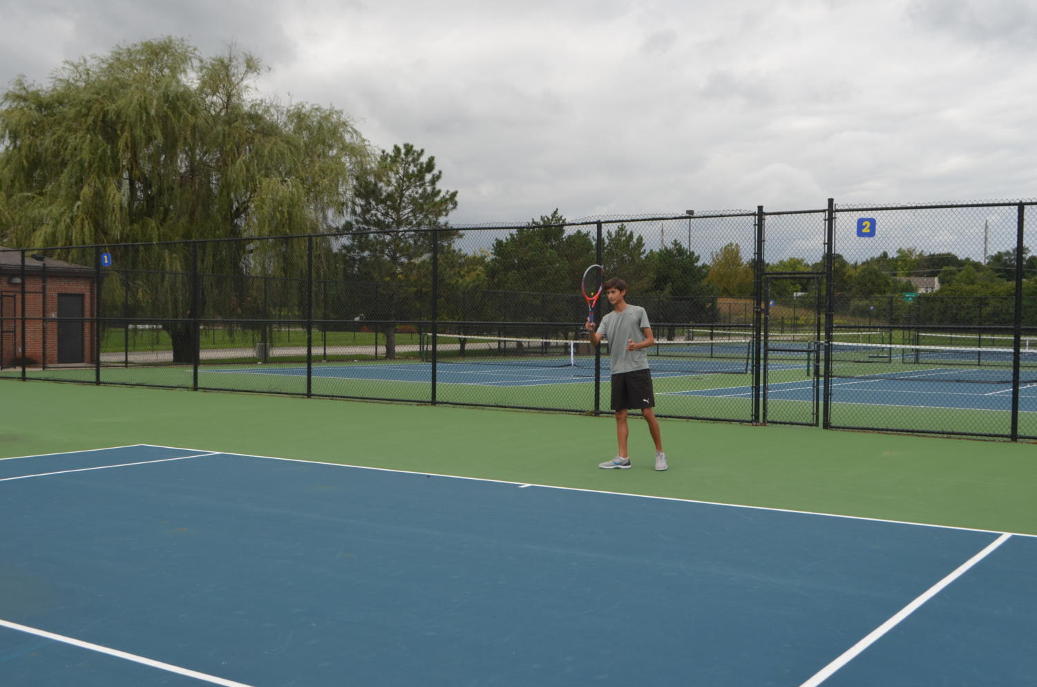 Will Brune, varsity tennis player and senior, hits the tennis ball during practice. The men's tennis team plays at the MIC Championship on Sept. 13 at Ben Davis High School.