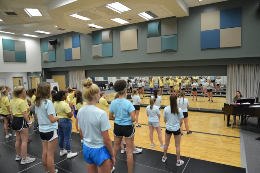 """Accents watch Director of Choirs Kathrine Kouns for further instructions on choreography. They rehearsed the song """"Fire Under My Feet,"""" which is their only choreographed piece for the upcoming fall concert on Oct. 9."""