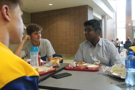 "Rik Bag (right), Carmel Mayor's Youth Council (CMYC) president and senior, talks with friends during lunch. Bag said, ""CMYC is kind of like a mix of the best high schoolers in the entire community. It's a really good environment to be able to speak your thoughts about whatever we're discussing at that time."""