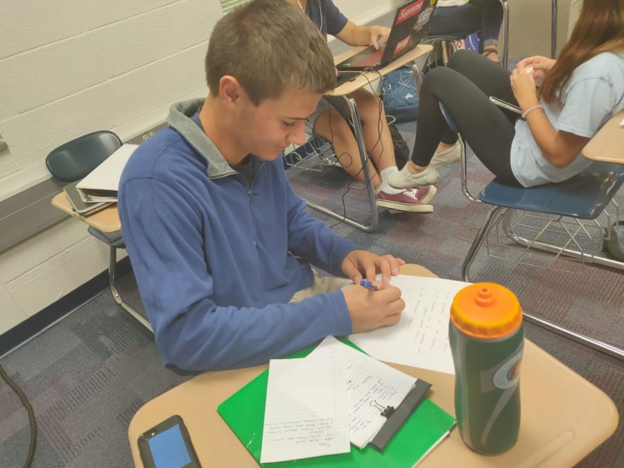 Student body president Tim Metken looks over upcoming plans for Senate and writes down important dates for Homecoming. Michelle Foutz, Senate sponsor and social studies teacher, said other than upcoming changes with the trike race, Senate is also looking for ways to allow the student body to watch the Homecoming parade.