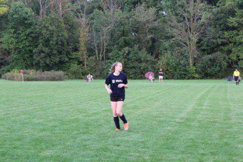"Maggie Killian, soccer player and freshman playing a game at CDC's Shelbourne fields. Killian talks about how much she has enjoyed playing CDC for the past three years. ""It's a lot of fun. There isn't a lot of conditioning or training so it's just fun to be able to go out and play,"" she said."