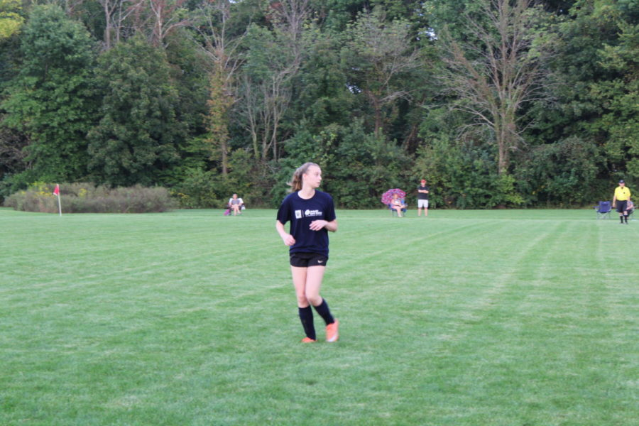 """Maggie Killian, soccer player and freshman playing a game at CDC's Shelbourne fields. Killian talks about how much she has enjoyed playing CDC for the past three years. """"It's a lot of fun. There isn't a lot of conditioning or training so it's just fun to be able to go out and play,"""" she said."""