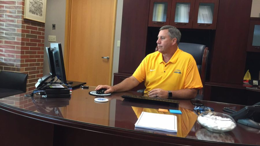Principal Tom Harmas works on his computer in his office. Harmas said as the school year begins, he is focusing on methods of improving safety at CHS.