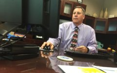 Principal Tom Harmas coordinates Homecoming parade viewing, new graduation pathways program
