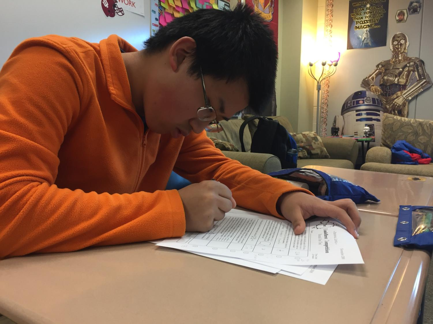 Math Club member and freshman Austin Guo works on a practice worksheet for the Mandelbrot competition. The Mandelbrot is a five-round math competition, with each round getting consecutively harder.