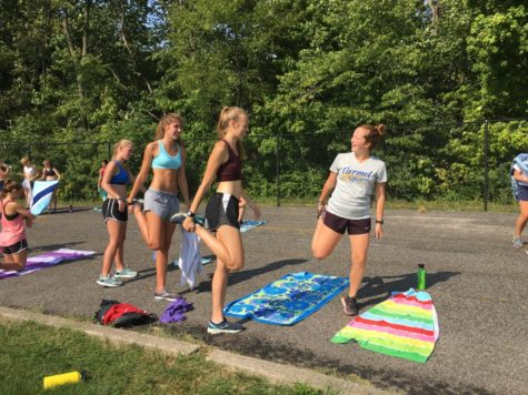 Senior runners of the women's cross country team help start off stretches before a practice leading up to the MIC tournament. McCormack, pictured far right, is excited to see how the team will perform in their upcoming race.