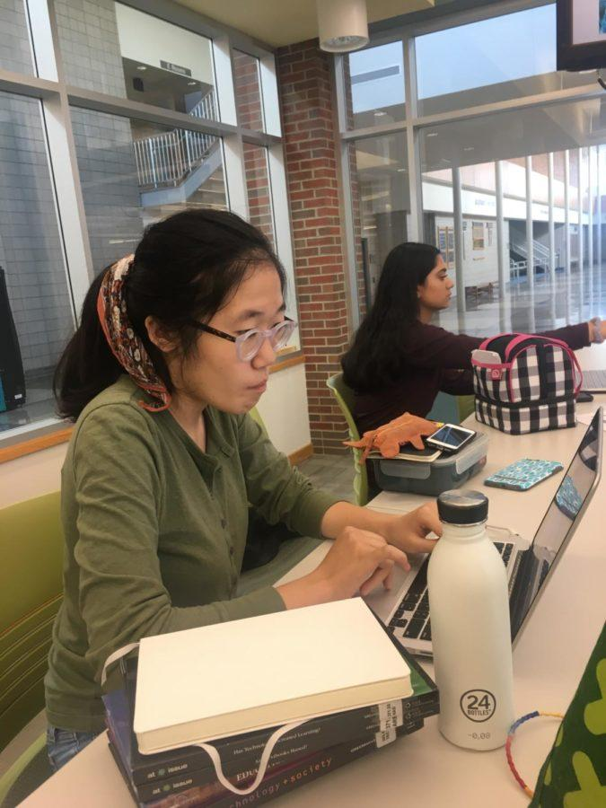 Selin Oh, TEDx president and junior, works on homework in the library during one of her release periods. Oh said that she hopes to see new members join this year.