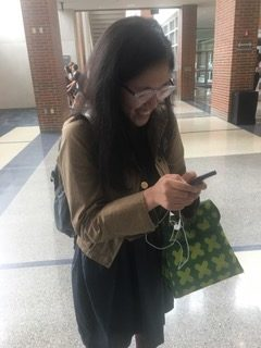 Selin Oh, TEDx president and senior, looks through her phone.  Oh said she looks forward to seeing the speaker auditions on Oct. 2.