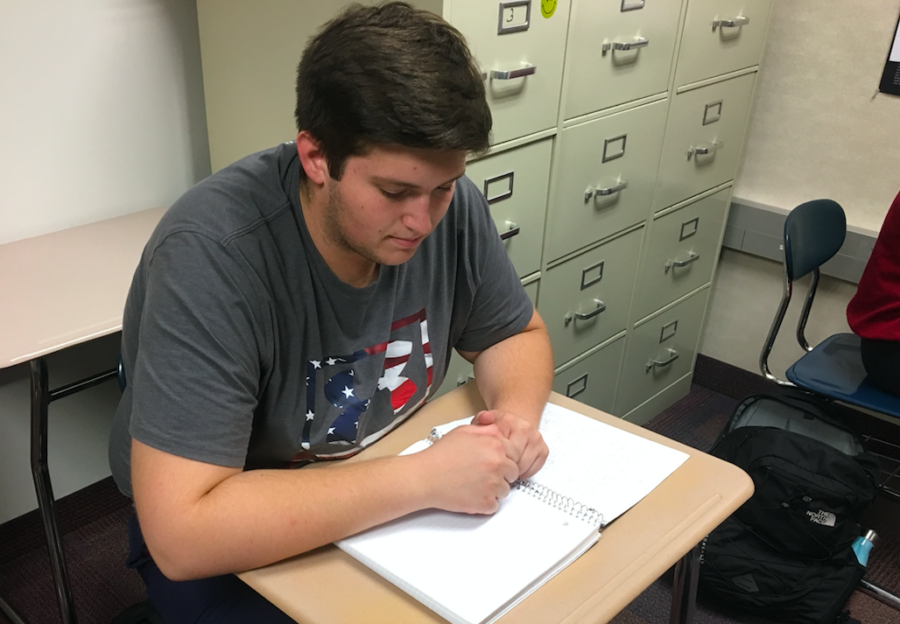 Mentor and senior Cameron Clark studies in K-8 Mentoring teacher Robin Pletcher's SRT. The class is currently in the middle of their two-month training process which they must complete before becoming a mentor for the 11 elementary and middle schools in Carmel.