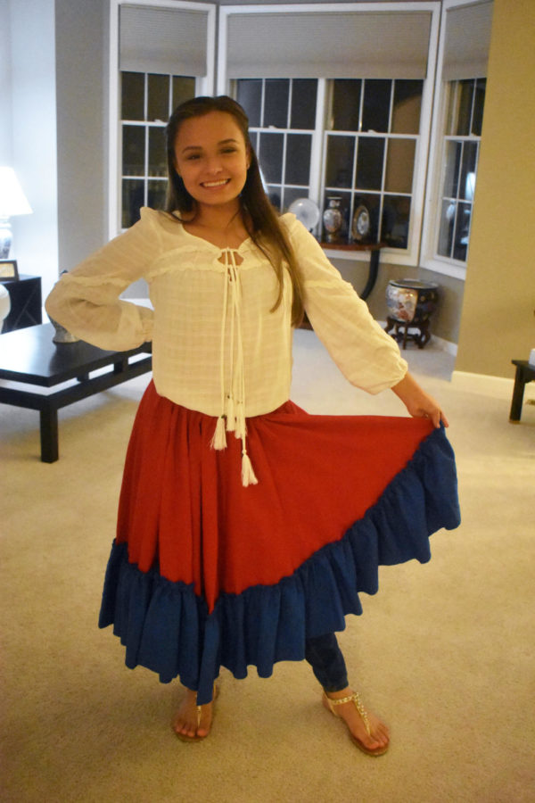 """Sophomore Alexandra Ortiz displays her traditional Puerto Rican skirt, which she said is part of the """"jibara"""" outfit. She said when she lived in Puerto Rico, her school would often perform these dances, and during these dances, the students would adorn the traditional skirts. Ortiz said she still wears them while dancing certain styles such as """"bomba"""" and """"plena"""" during family gatherings."""