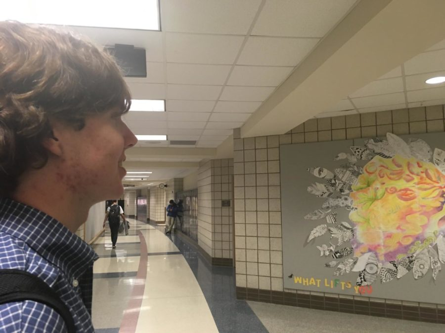 "Senior Joseph ""Joey"" Heerens looks out at CHS. Heerens expressed concerns that the school building is too large in order to properly enforce the current safety measures."