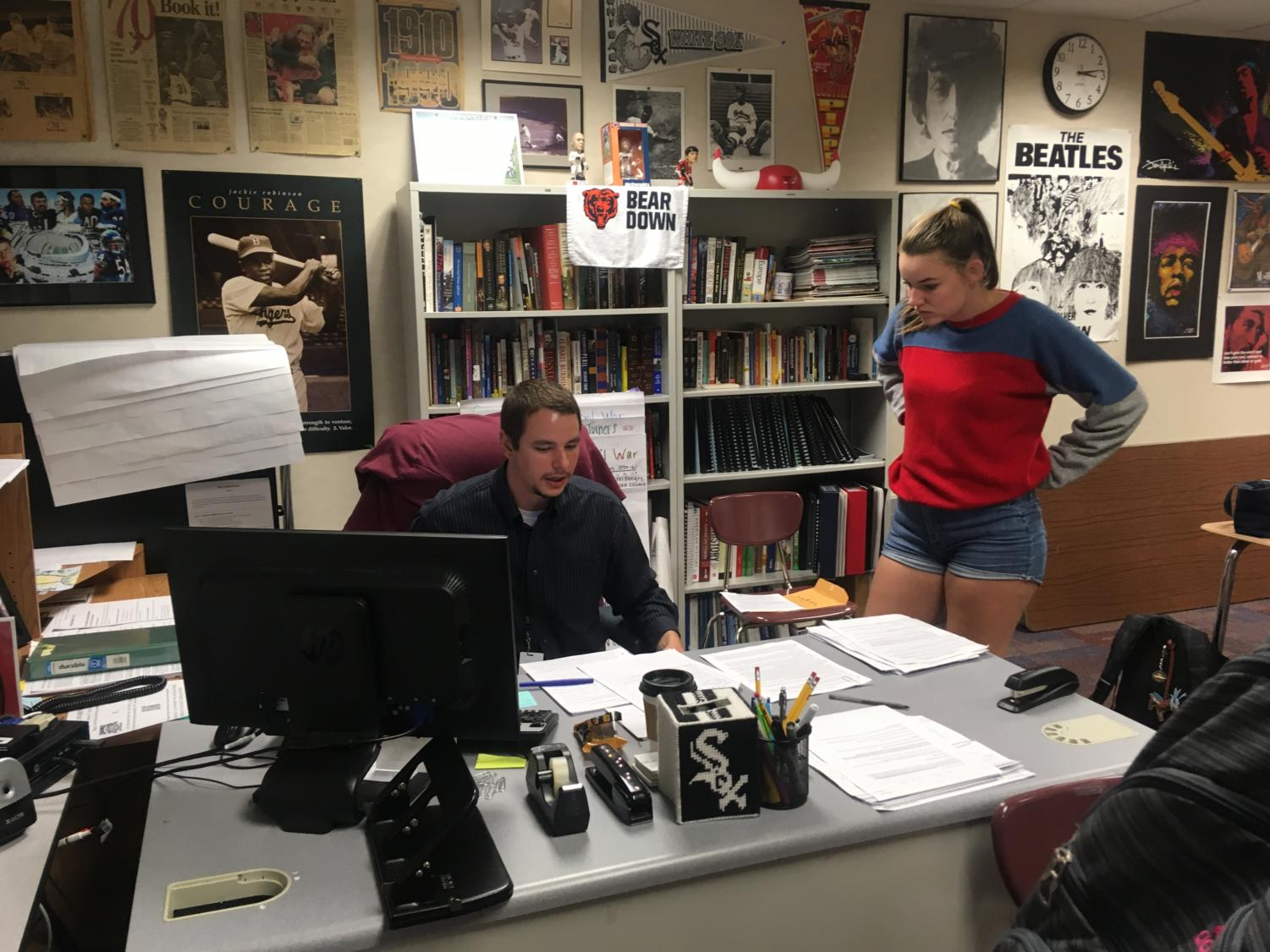 Do Something Club sponsor James Ziegler and Samantha Kadinger, Do Something Club member and senior, discuss details for the club's current projects. According to Ziegler, the club is currently conducting their canned food drive for the SENSE Charter School in Indianapolis, and their breast cancer research fundraiser will take place on Oct. 12.
