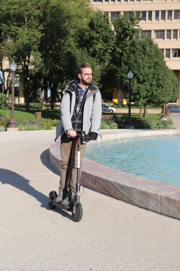 """Indianapolis resident Shane Luttrell rides a Bird schooter through Indanapolis. """"It's no carbon emission, it doesn't do any kind of damage to the community, so it's a benefit,"""" Luttrell said, """"Everyone that I see that is driving on these, they're smiling, you can actually enjoy yourself."""""""