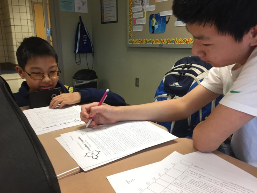 Math+Club+member+and+freshman+Jacob+Zhang+works+alongside+fellow+Math+Club+member+and+freshman+Jack+Liu+on+the+first+round+of+the+Mandelbrot+competition.+The+Mandelbrot+took+place+on+Oct.+2+in+H207.