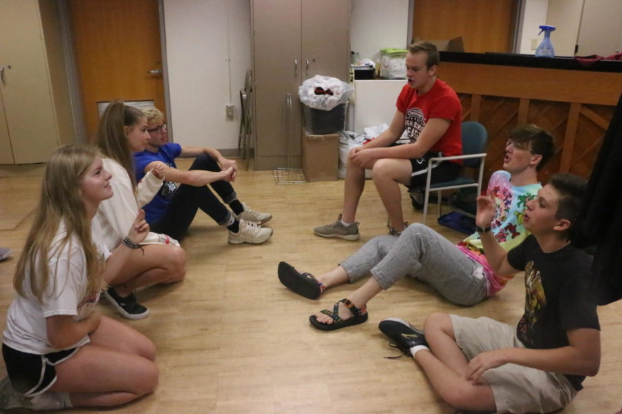 At a ComedySportz Workshop, veteran ComedySportz members discuss the rules of a ComedySportz improv game. In addition to comedic improv skills, the game also involved singing and rhyming.