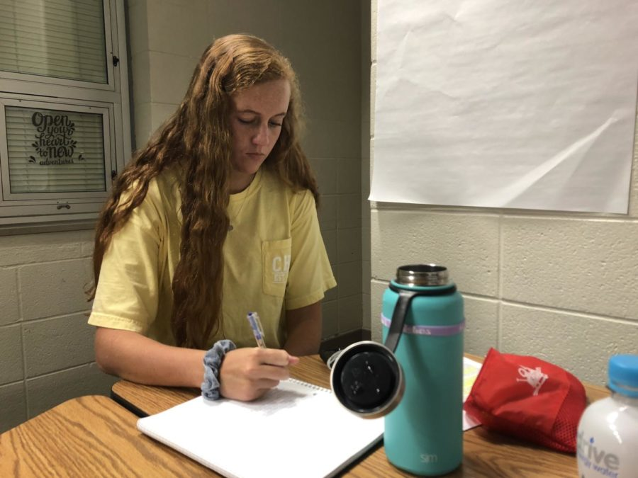 Club officer and senior Melissa Settle works on homework during SRT. She said she's excited to see how all the buddies will interact with each other as the year goes on, and especially to see them together at the Halloween party.