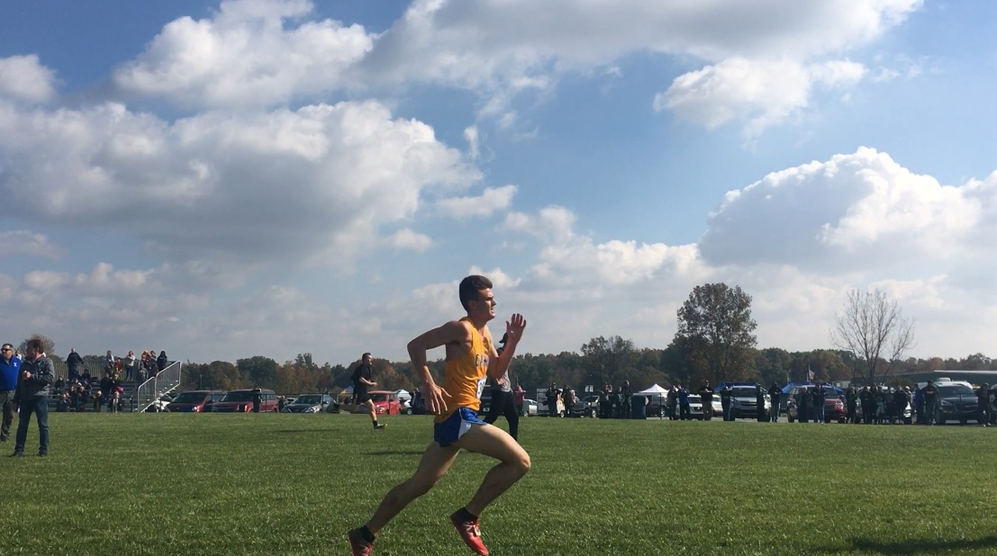 Senior Calvin Bates sprints to the finish line at State on Oct. 27. Bates placed 19thwith a time of 16:14.0.