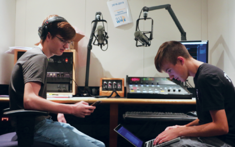 Rapper and sophomore Isaac Brown (left) prepares to record his new songs alongside DJ and sophomore Ethan Meneghini (right) in one of the school's recording studios during late start. This was the first time the pair had worked together. Both Brown and Meneghini said they were excited to begin working.