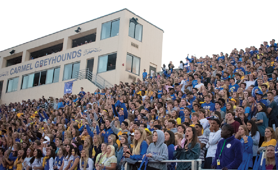 Focused Fans: Students cheer and focus at the Homecoming football game on Sept. 28. Carmel won the game against Ben Davis, and Senior Hannah Nist was crowned Homecoming Queen. Carmel will go on to play Westfield in Sectionals at home on Oct. 26. The game will start at 7 p.m.