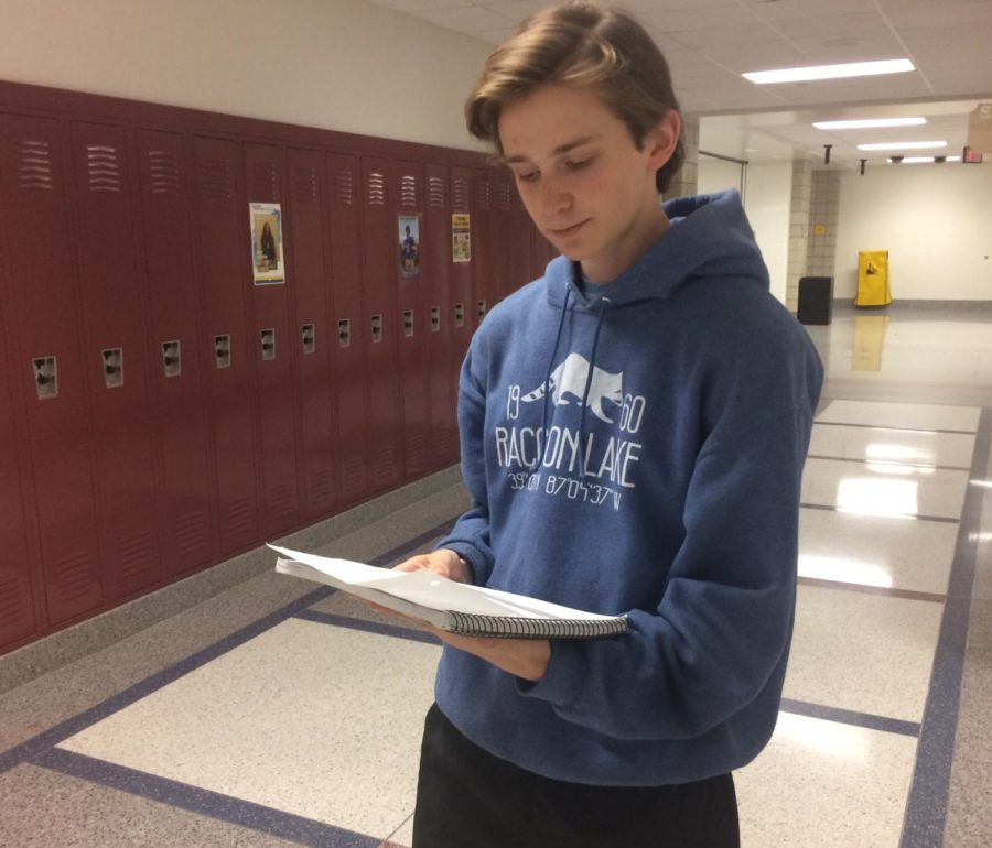 """Junior Finlay """"Finn"""" Waugh goes over his notes for his classes. He said AVID teaches him how to efficiently get his work done. """"AVID is pretty good because it teaches me different ways to take notes and do better in my classes,"""" Waugh said."""