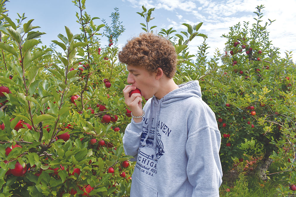 Junior Zach Berman bites down on one of the apples from Stuckey Farm's apple orchards. Stuckey Farms has around 4,000 trees and boasts 27 different types of apples, as well as a 15-acre pumpkin patch, an eight-acre corn maze and many more activities.