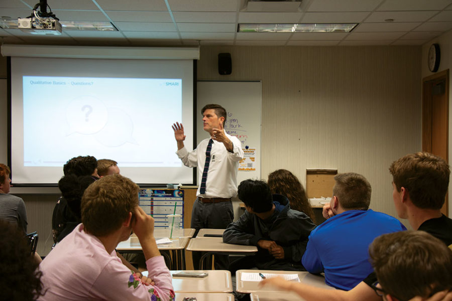 REDESIGNING DESIGN: Marketing expert Gerald Gerard explains to IB Business students how to successfully moderate a focus group for their CCS rebranding design. The students identified a multitude of stakeholders in the project and determined that focus groups would be the best way to include their opinions in the final design.
