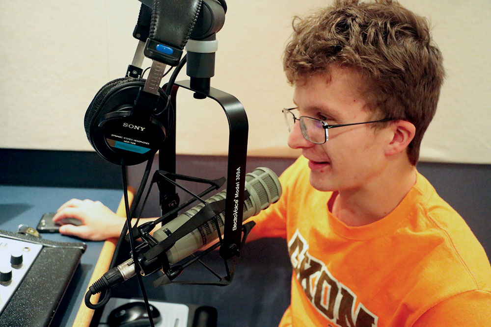 Radio Recording: Senior Ethan Wakeman talks into his microphone during a recording session at the CHS recording lab. He said radio is a fun way to express himself.