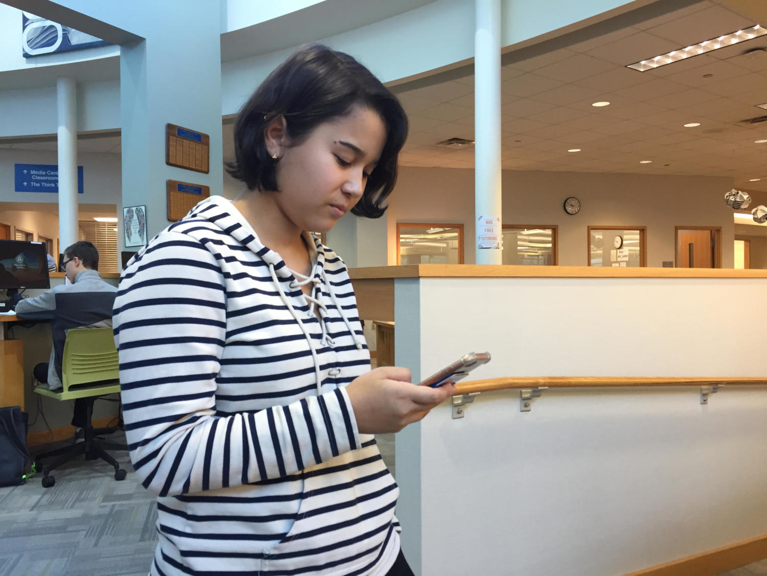 Sasha Matsuki, Teens with a Choice president and senior, browses on phone during SRT. Matsuki said she is excited to see the club members solidify fundraising plans this year.