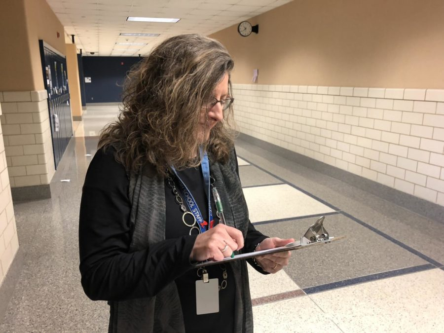 Co-sponsor of Lifelines Rebecca Overbey writes down plans for the annual pre-winter break week. Overbey hopes the activities planned will help students learn the importance of being drug-free.