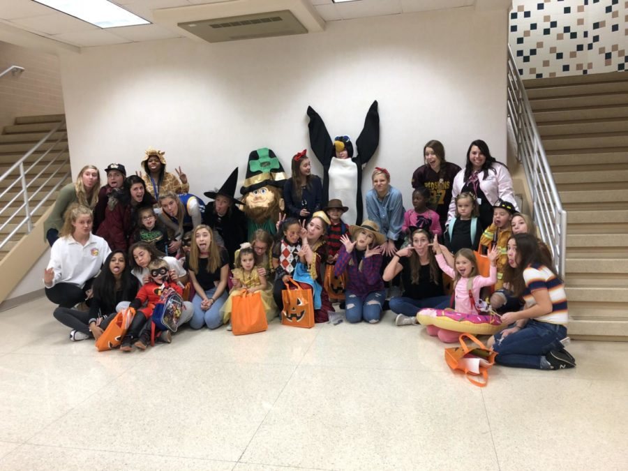 The students of Advanced Child Development take a 'goofy' group picture along with the preschoolers after trick or treating.