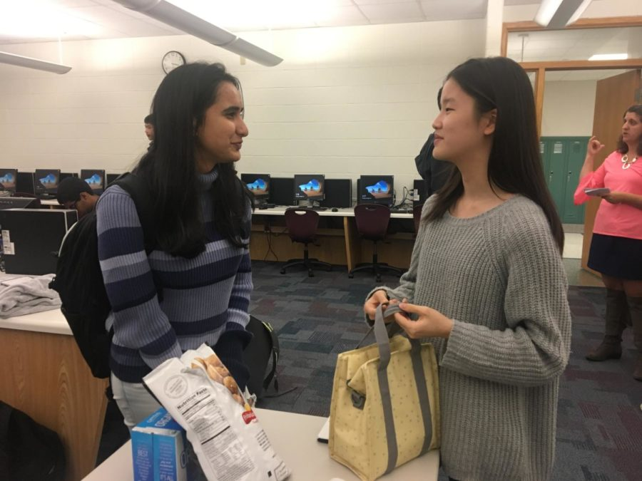 Juniors Shivani Balachandar and Hannah Na discuss Hands on Education at the last Design for CHS meeting on Oct. 16. Design for CHS has been visiting IPS schools every Friday to teach fifth graders more about science.