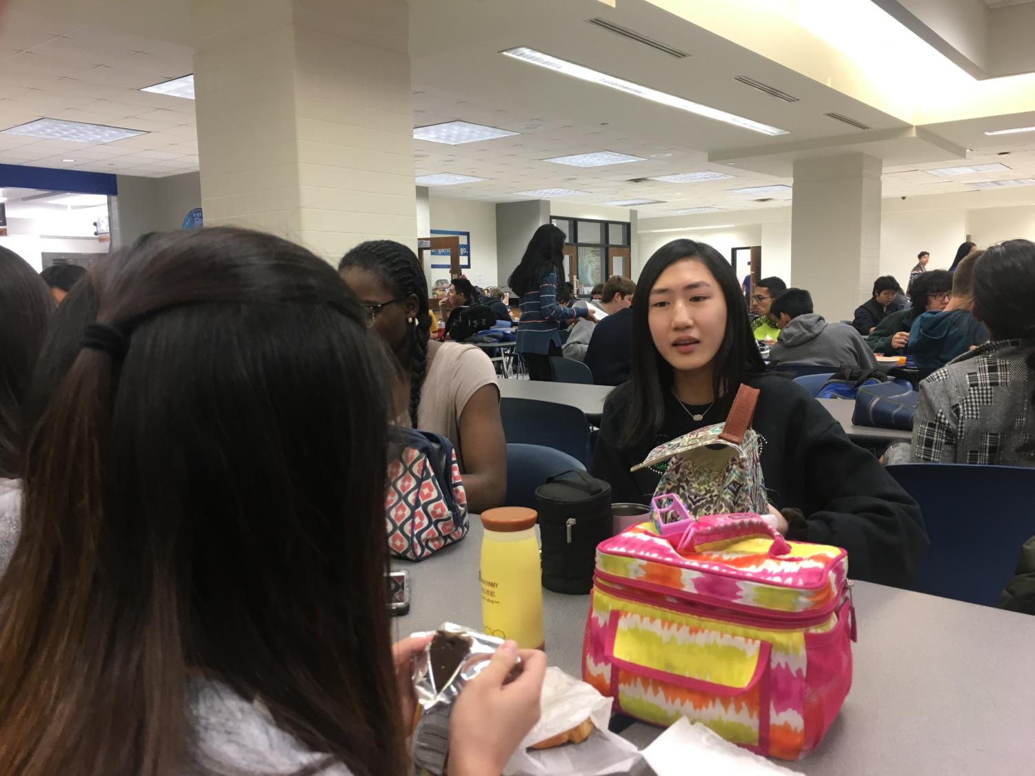 Sophomore Carol You talks to her friends during lunch. You said she is excited to give a TED talk at the conference on Dec. 1 about Asian misrepresentation in the media.